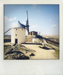 Windmills and Castle with the town of the Consuegra in the Distance